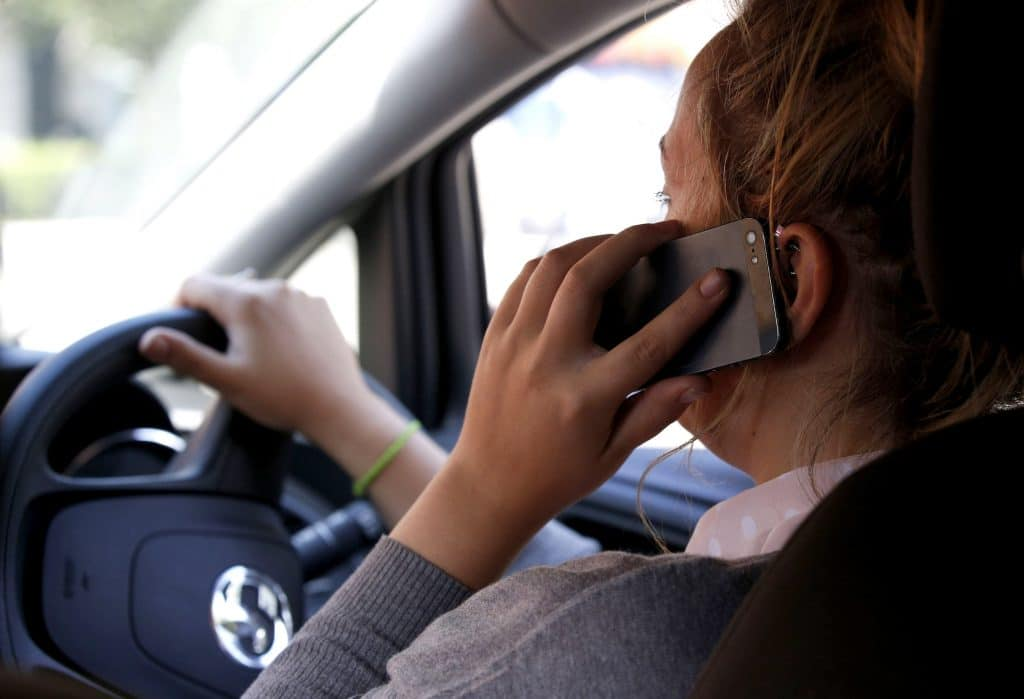 Increased penalties for mobile phone use at the wheel cuts offences by half